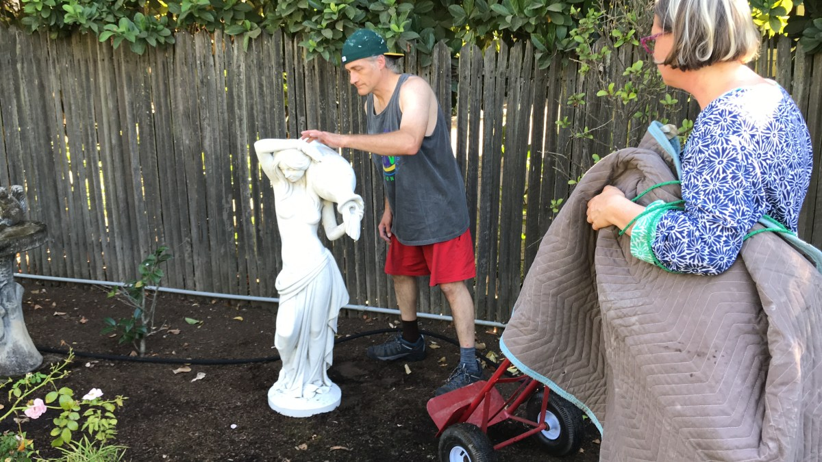 Frank's nude statue in its new home in the garden