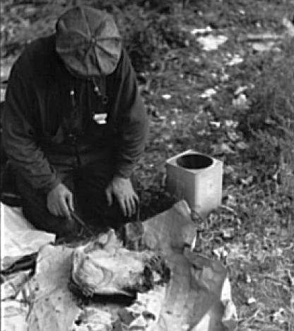 Great Depression: Man in hobo jungle killing turtle to make soup, Minneapolis, Minnesota. Photo by John Vachon. Courtesy Library of Congress, Prints & Photographs Division, FSA-OWI Collection LC-USF33- 001521-M3