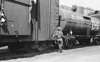 Great Depression: Boy hopping fright train, Dubuque, Iowa. Photo by John Vachon. Courtesy Library of Congress, Prints & Photographs Division, FSA-OWI Collection LC-USF33- 001772-M5