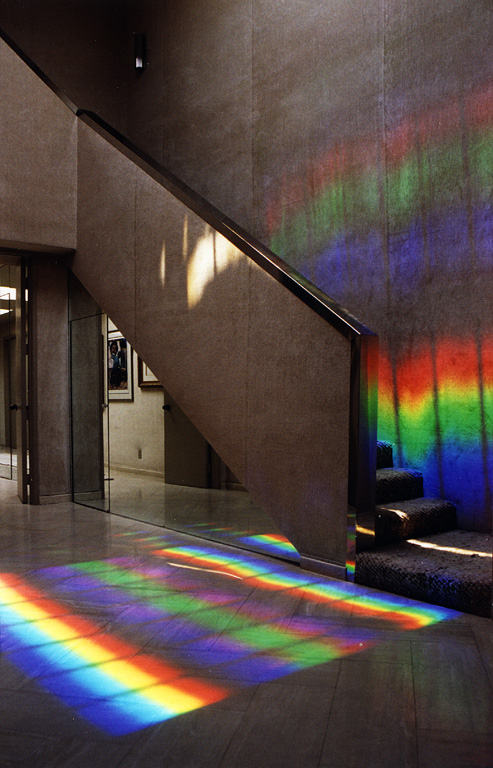 The floor is painted with ever changing carpets. of light. this is 100% sustainable green art