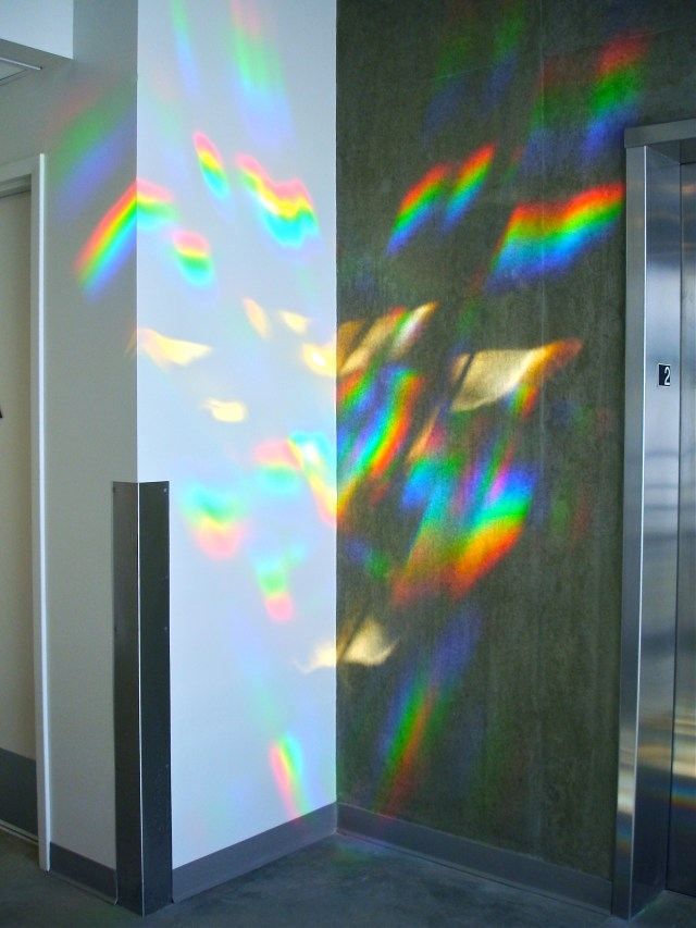 detail of rainbow light art splashes on LAPD lobby elevator. Erskine Solar Art