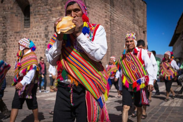 CUSCO, PERU - SEPTEMBER 7: Unknown Peruvian people in traditional clothes on a carnival in Cuzco, Peru, 7 Septiembre 2014. Every year in Cuzco passes many religious holidays and carnivals