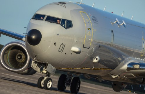 Image shows the first RAF P-8A Poseidon taxiing at NAS Jacksonville after being delivered to the RAF as the first P-8A Poseidon. The first submarine-hunting Poseidon MRA1 Maritime Patrol Aircraft (MPA) has been delivered to the Royal Air Force. The MOD is investing £3 billion in nine state-of-the-art jets which will enhance the UK's tracking of hostile maritime targets, protect the British continuous at-sea nuclear deterrent, and play a central role in NATO missions across the North Atlantic. The aircraft left Boeing Field, Seattle, flying under the callsign POSIDN1, flying across the United States of America, before touching down at Naval Air Station Jacksonville where Air Officer Commanding Number 1 Group, Air Vice-Marshal Harv Smyth, took delivery of the first Royal Air Force P-8A Poseidon.