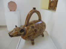 A traditional water jug form, in the shape of a dog. From Colima.