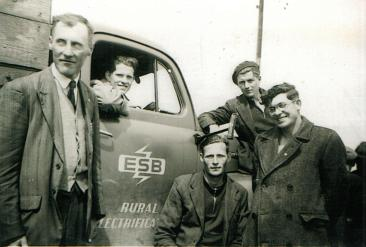 Tim with his colleagues (L-R): Willie Joe Kelly, hackney driver; Paul Slevin, Tipperary; Tim; Micky Herron, linesman, Donegal; unknown.