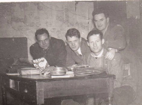 Tim with his colleagues in Belmullet (L-R): Jack Glynn, truck driver, holding December 1957 issue of REO News; Barry Ormond, clerical officer; Tim; and Pearse Dawson, rural canvasser.