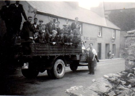 Tim's rural gang in ESB truck outside McShane's Bruckless, Donegal on the way to work, August 1951