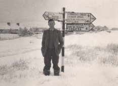 Tim standing at a crossroads in the Big Snow of 1958. A depth of 17cm was recorded at Belmullet on the 24th January, the greatest depth of snow ever recorded at this station.