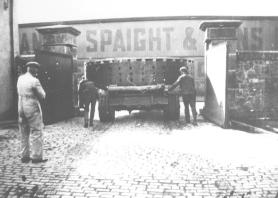 Transport of generator component past Spaight & Sons, Limerick, May 1933
