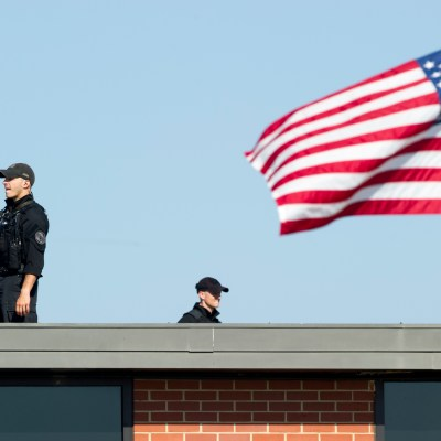 A Secret Service Counter Sniper team does a scan of the area while awaiting the arrival of President Barack Obama at Andrews Air Force Base, Md., Wednesday, June 29, 2016. (AP Photo/Cliff Owen)