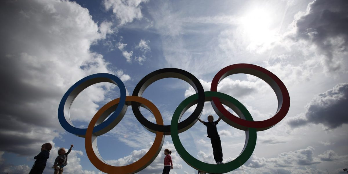 Children play on the Olympic rings at the rowing venue in Eton Dorney, near Windsor, England, at the 2012 Summer Olympics, Monday, July 30, 2012. (AP Photo/Natacha Pisarenko)