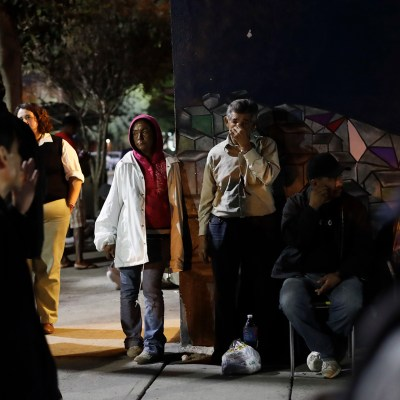 People stand in front of a shelter for migrants on their way to the United States and for deported migrants, Monday, Nov. 14, 2016, in Tijuana, Mexico. In an interview with CBS'