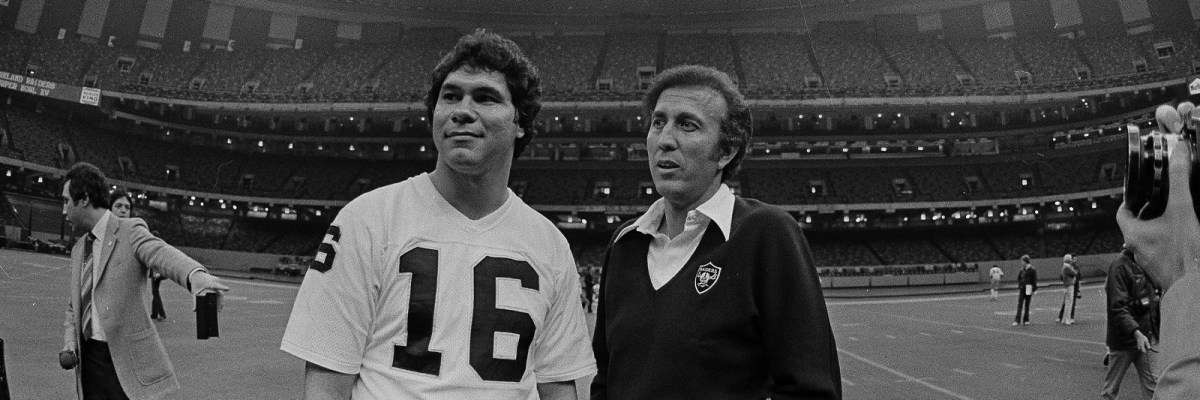 Oakland Raiders quarterback Jim Plunkett and head coach Tom Flores look over the Superdome in New Orleans before a team practice, Jan. 21, 1981. (AP Photo)