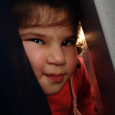 This is Mais, a two-year-old diaspora Palestinian, who was travelling with her mother, father, and brother to Jordan, before continuing their travels to the West Bank to visit Mais' grandparents. Humbling flight company [London-Amman flight, somewhere in the sky].