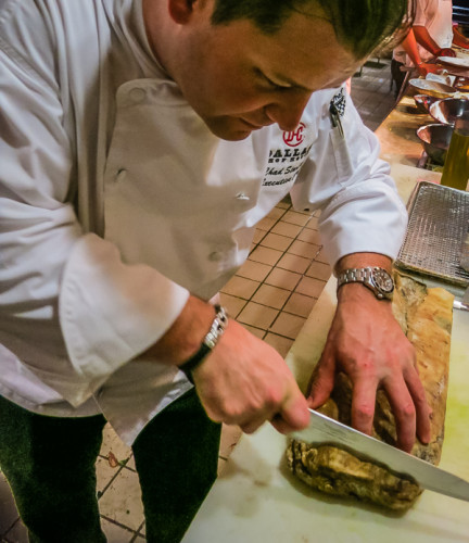 Dallas Chop House chef Chad Starling slices into a 459-day dry-aged prime beef rib-eye