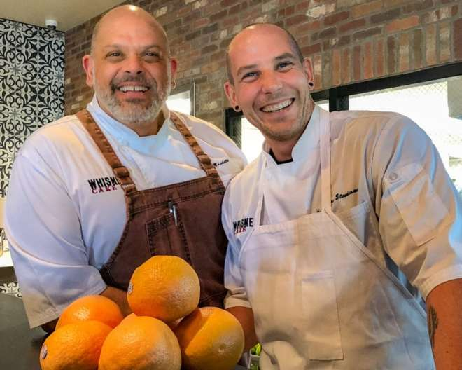 Chefs Jeff Moschetti and Aaron Staudenmaier of Whiskey Cake. Whiskey Cake Kitchen and Bar in Las Colinas is a casual, farm to table restaurant with scratch cooking and a 400-label whiskey collection. Whiskey Cake is owned by Dallas-based Front Burner Restaurants. It is a cas