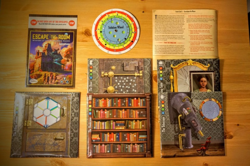All of the included materials inside the box of Mystery at the Stargazer's Manor.