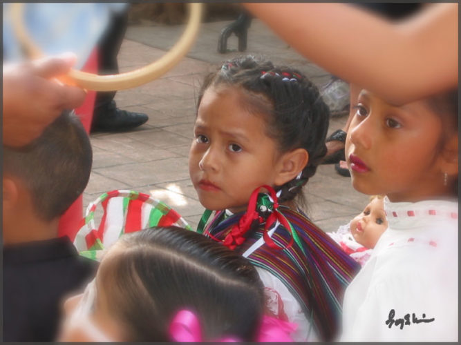 Little girl dressed up for Independence Day parade along with other Ajijic people.