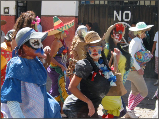 Group of partyers with different mask in the Carnival parade.
