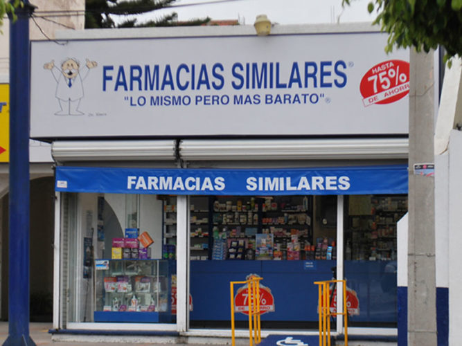white and blue farmacia similares sign above store entrance with counter and stocked shelves inside