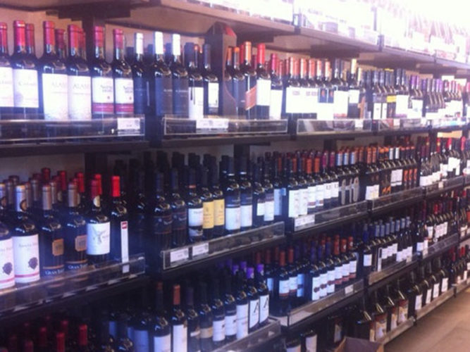 Four rows of wine stacked shelves in Vino America in Ajijic, Mexico.