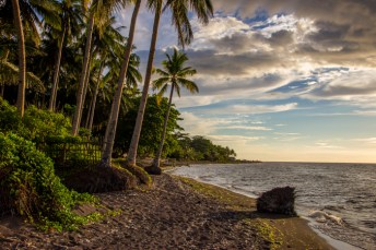 The resorts beach ... black sand due to the many volcano eruptions.