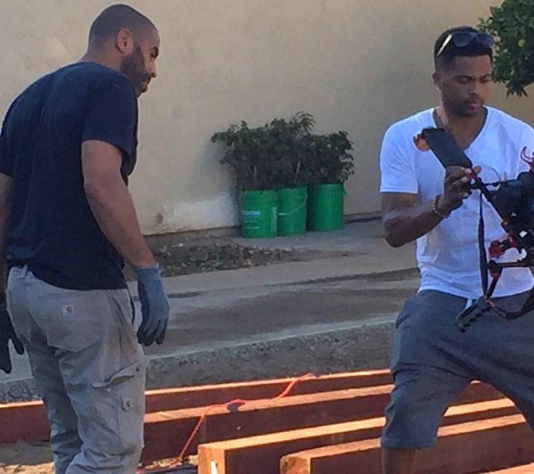 """""""Yard Crashers"""" Ahmed Hassan with cameraman at the secene."""