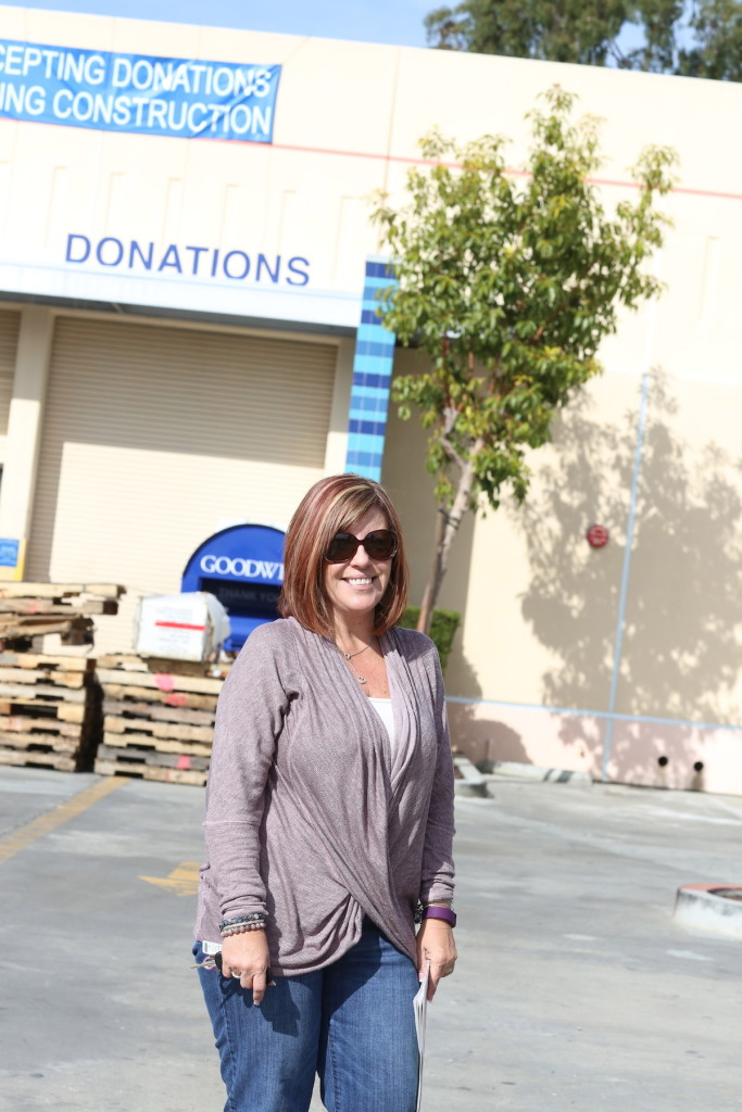 Beth Forsberg, Goodwill Industries of the San Diego county vice president, retail and operations surveying the clean-up last week. (Shawna Henrie/bleudogfotography.com.)