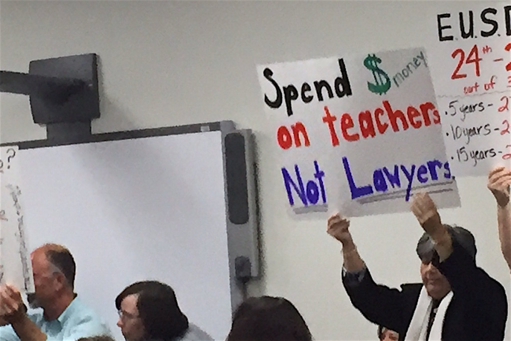 Teachers and supporters protest low wages at last EUSD Board meeting.