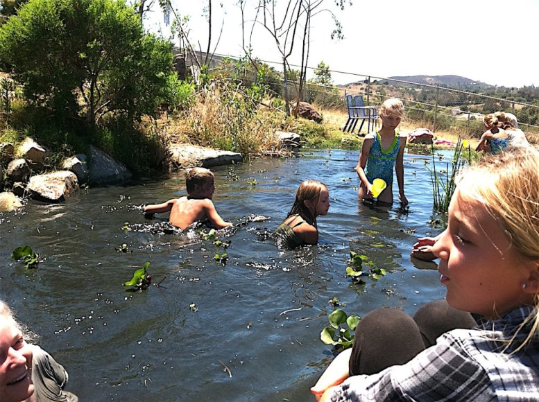Kids hit the natural pond at Bheau View Ranch, Twin Oaks.
