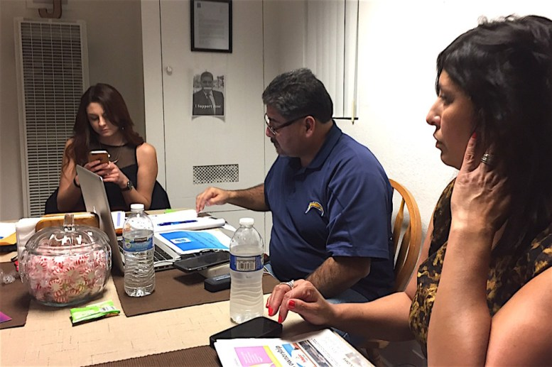 EUSD Board member Jose Fragozoo at a residence two miles away from the meeting with Carmen Miranda-Griffith, right and Miranda Griffith, left.