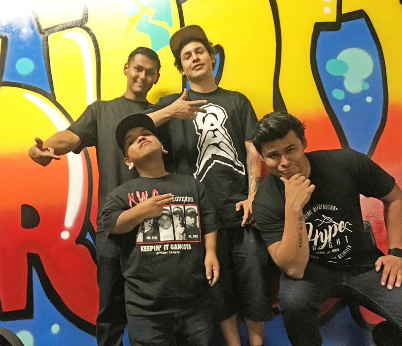 (Top left to bottom left) Eric Munoz, Self Provoked, David Munoz and Self Provoked's posse give a what's up to the people.