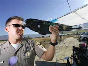 Los Angeles Sheriff's Department sergeant checks out a drone.