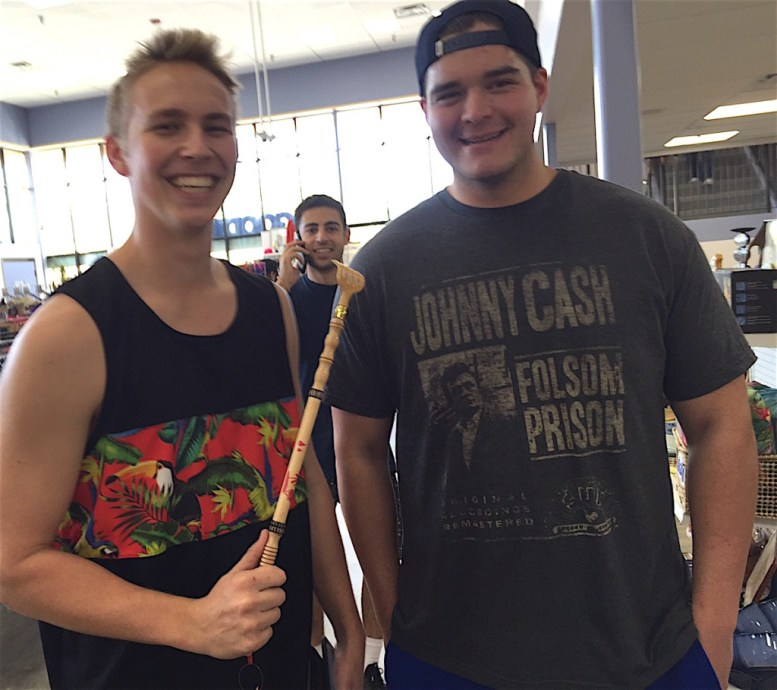 Cal State University San Marcos students Kyle Skachenko, left, and Jimbo Stumpff, with an unidentified colleague photobombing, stopped in while waiting for a friend to get his towed car back.