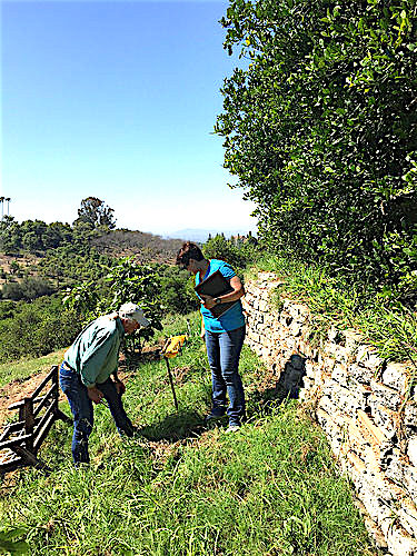 Commander Everest (right) and a Conservation District employee (left) inspect a recently installed underground outlet. (NRCS photo.)