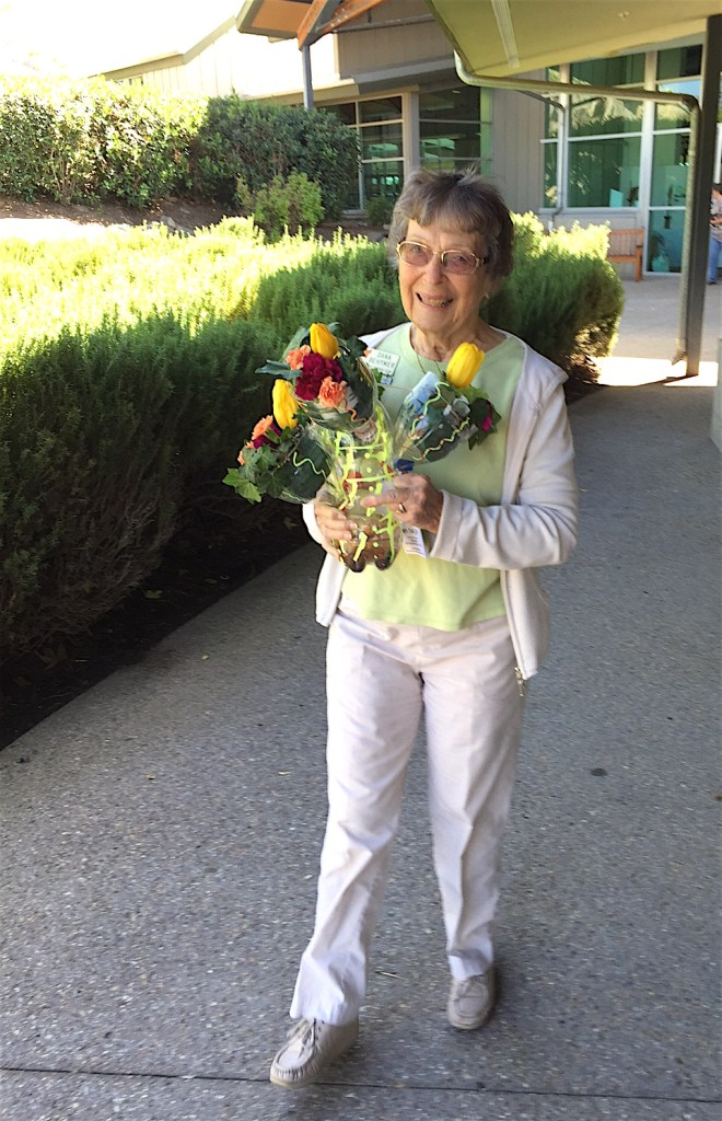 Dana Behmer carried a Valley Center high School Floriculture Club display back to the car that would take it back to school.