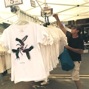 Beverly Hills artist and T-shirt designer John A. Conroy takes care of business for the last time.
