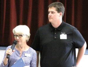 Scholarship Chair Helen Borchelt introducing Harrison Bauer.