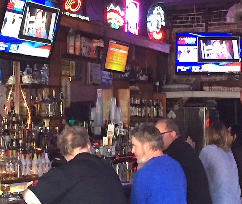 Meanwhile, the Pounders crew seemed oblivious to election coverage blaring on TV sets above the long bar.