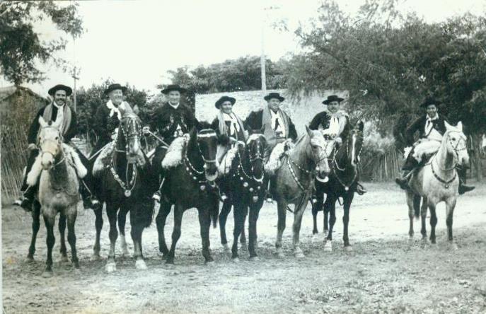 Gauchos and horses