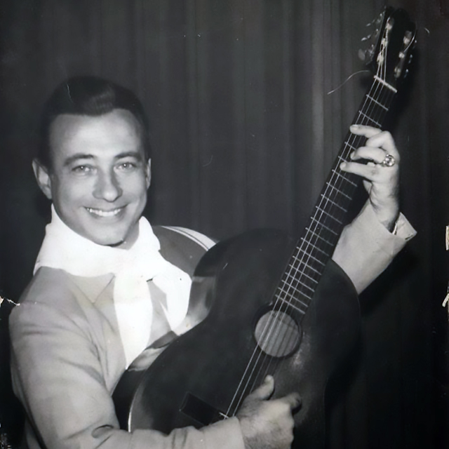 Carlos Acuña playing guitar, Argentine Tango singer and composer.