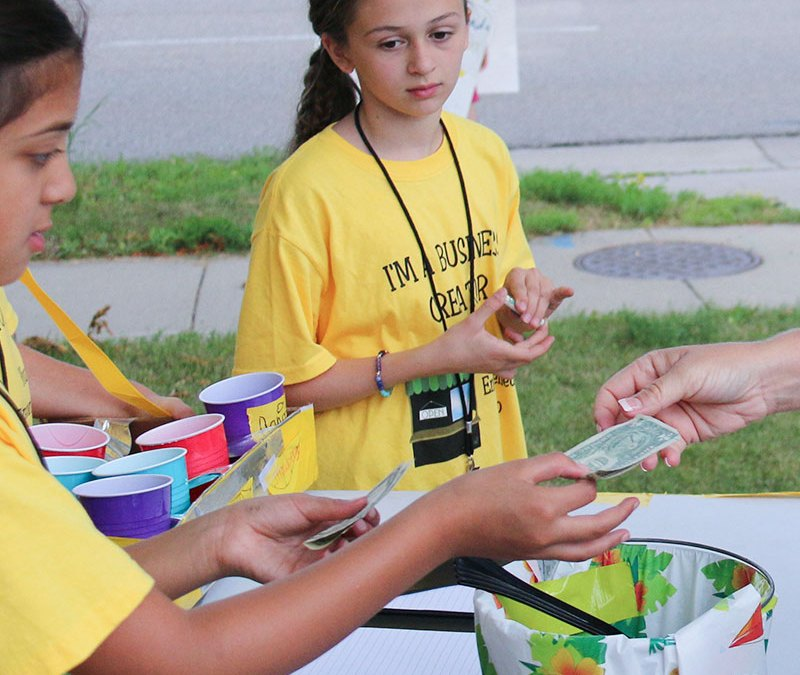 youth entrepreneurs running lemonade stand