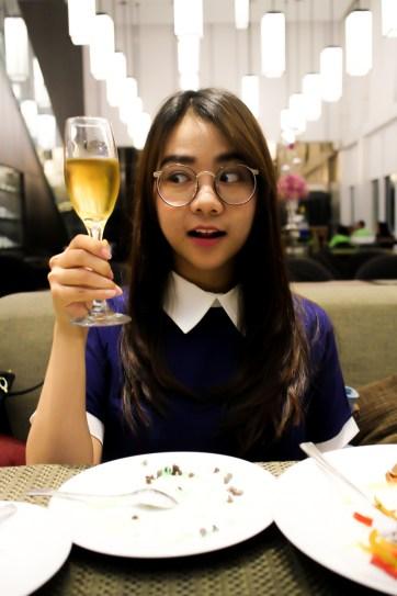 Clara holding a lemon tea (mind you, no alcohol for muslim mom), with the birthday present inside.