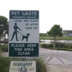 A park sign about pet waste and asking visitors to keep the park clean