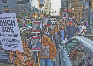 Thursday, Feb. 25 2016.    Protesters who rallied outside the downtown Seattle Police Department thread their way through traffic down 5th Ave. as they portest the killing of Che Taylor by Seattle Police.