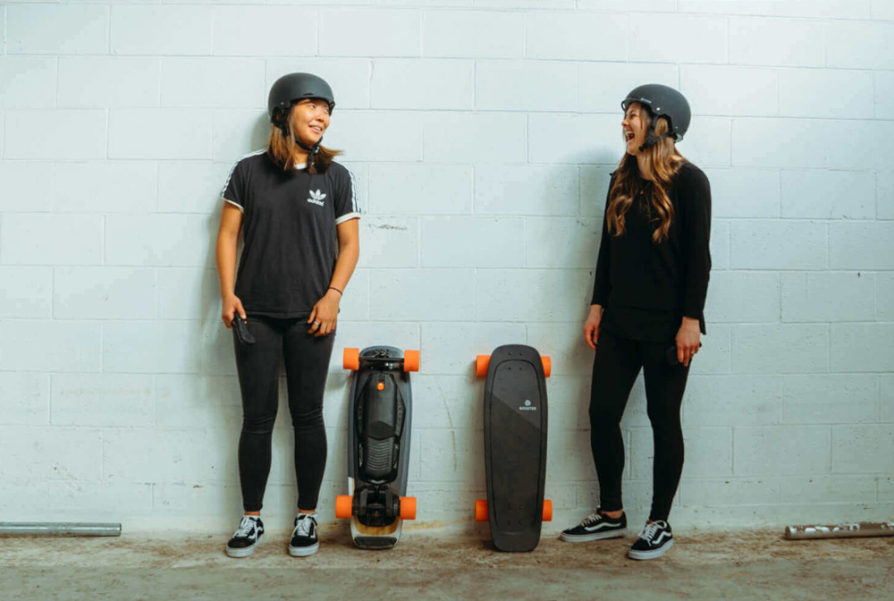 Two Skaters Chilling with their Boosted Mini's