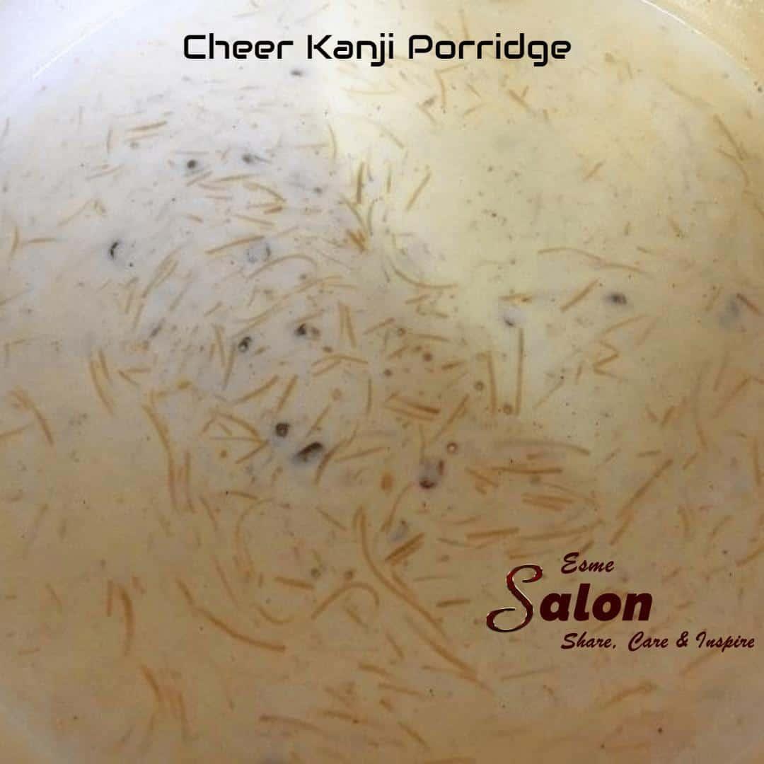 Prepare Ceer Kanji Porridge and break a Coconut