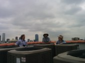 Esotouric's Richard Schave, sign restorer Paul Greenstein and neon historian Nathan Marsak enjoy the view