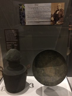 Jean-Louis Vignes' brandy still and strainer. On display at the Natural History Museum.