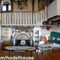 A panorama of the central hearth and projecting balcony. Sit a spell and perhaps George will play us a tune.
